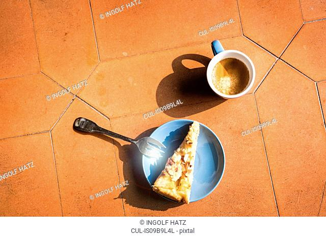 Overhead view of slice of cake and coffee