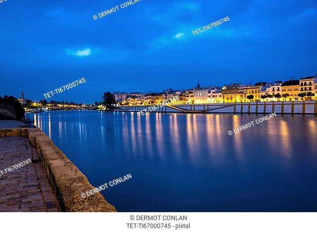 Spain, Seville, Triana, Guadalquivir river at dusk