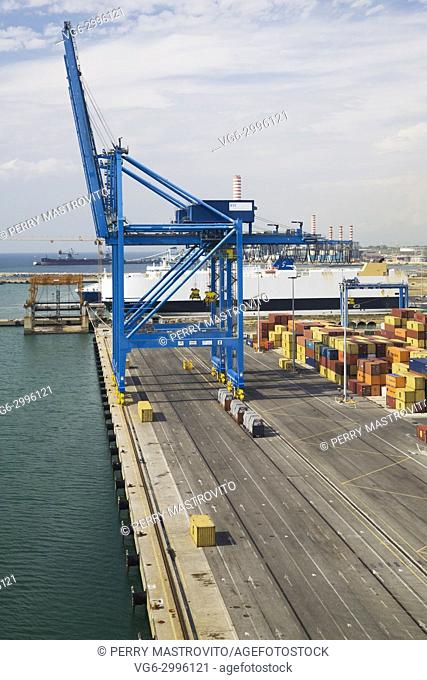 Top view of terminal with blue gantry crane and stacked shipping containers in the port of Civitavecchia, Lazio region, Rome Province, Italy, Europe