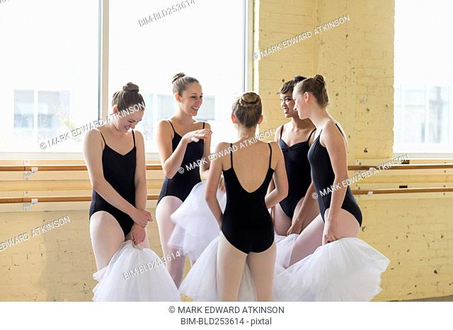 Girls standing and talking in ballet studio