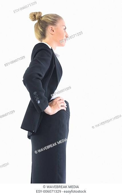 Low angle profile view of young businesswoman posing