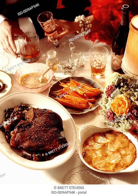 1920s style dinner scene with Cote De Boeuf