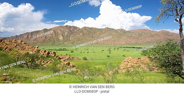 View into Marienfluss valley, North Kaokoland with Baynes Mountains in background. Namibia