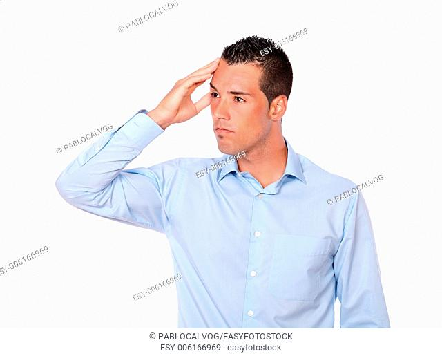 Portrait of a stressed young man with head pain standing while is looking at people on isolated background - copyspace