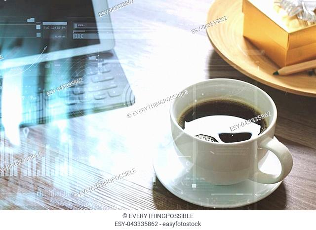 Coffee cup and Digital tablet dock smart keyboard,gold gift box and round wood tray,color pencil on wooden table,virtual interface business screen