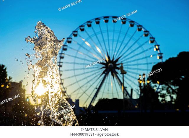 Water Fountain and Ferris Wheel in Sunset in Nice in Provence-Alpes-Côte d'Azur, France