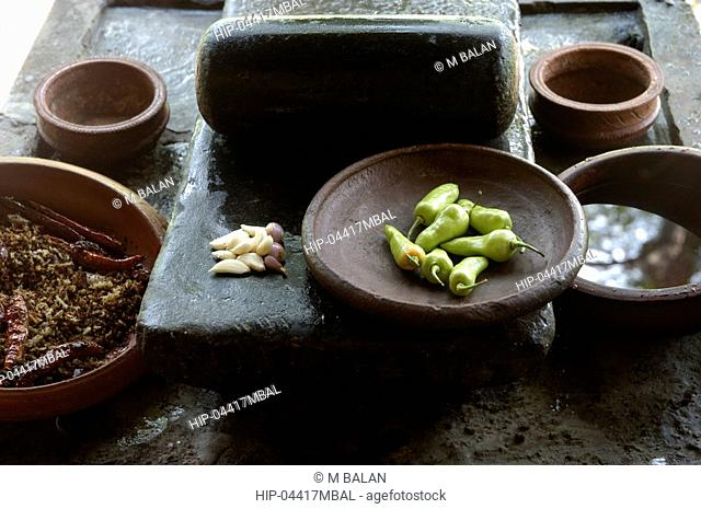PREPARING SPICES AND OTHER MATERIALS FOR KERALA CUISINE