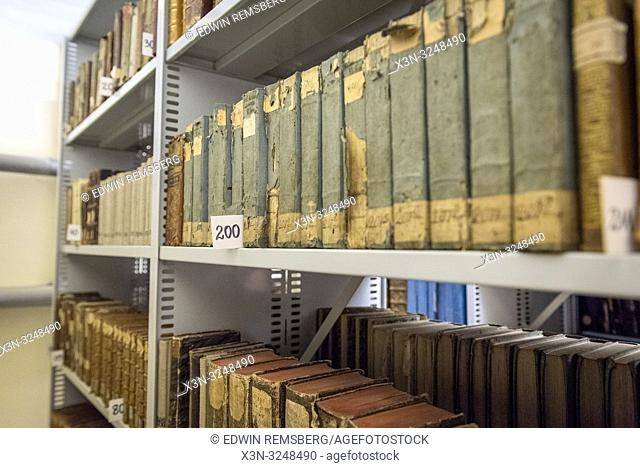 Several collections of older and original books sit organized by call number on library shelves. Central Agricultural Library, Warsaw, Masovian Voivodeship