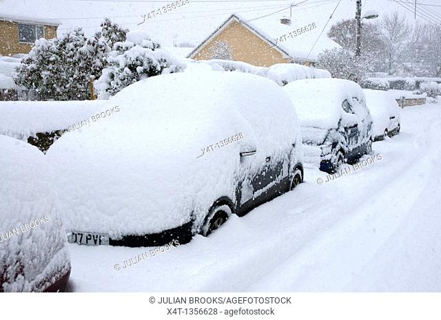 a blizzard covering cars in deep snow, Oxfordshire, Tackley