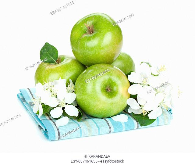Ripe green apples with flowers on towel. Isolated on white background