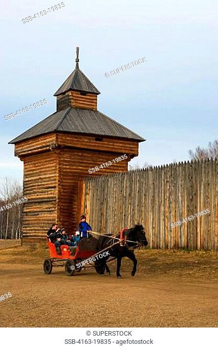RUSSIA, SIBERIA, NEAR IRKUTSK, TALTSY OPEN-AIR MUSEUM OF WOODEN ARCHITECTURE, TROIKA WAGON