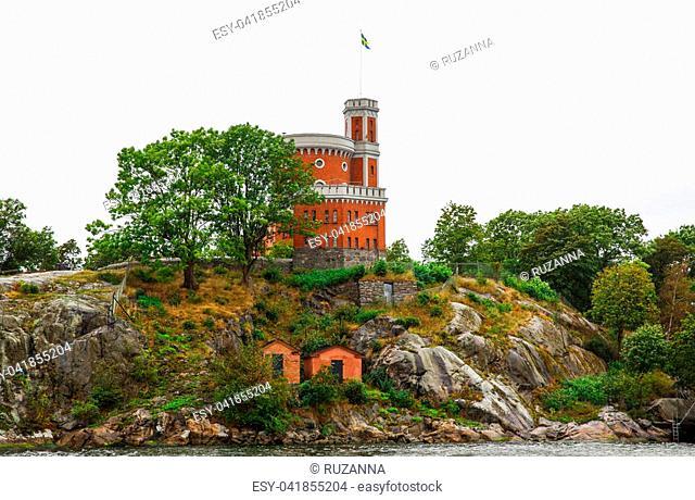 Kastellet with Swedish flag on Kastellholmen island in Stockholm, Sweden