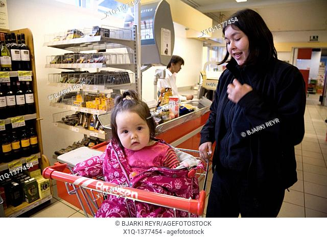 Woman and her daughter shopping at a local supermarket, Narsaq, South Greenland