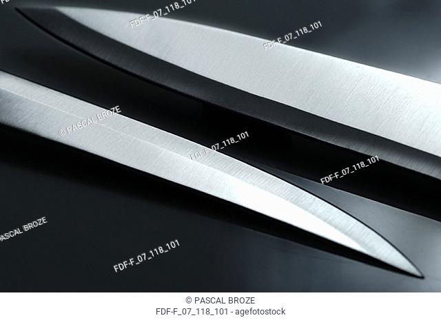 Close-up of two kitchen knives