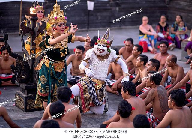 Dancers performing the classic Balinese Kecak Dance in Uluwatu Temple, Bali, Indonesia