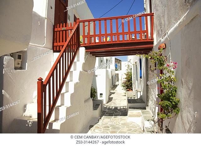 Whitewashed traditional Cyclades houses with colorful doors and railings in the most ancient village Kastro in Sifnos Island, Cyclades Islands, Greek Islands