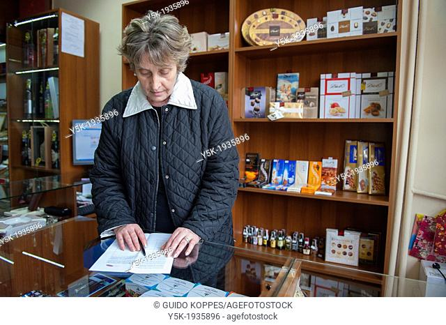 Sofia, Bulgaria. Middle-aged Bulgarian woman, working in her shop downtown Sofia