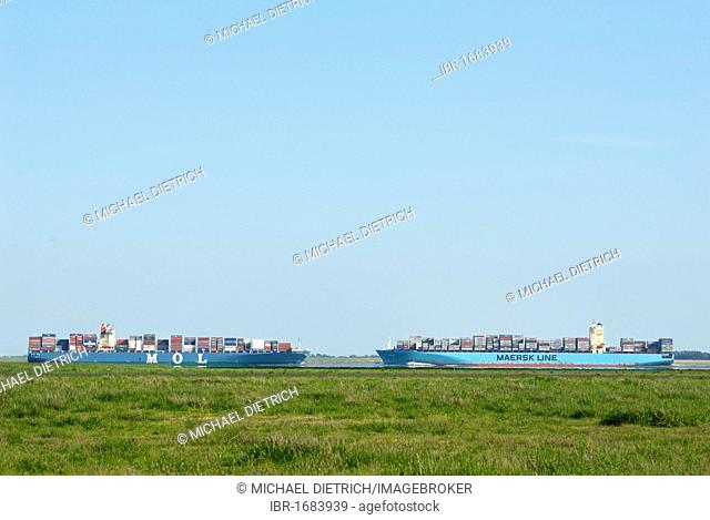 Two container vessels passing one another on the lower Elbe River, Schleswig-Holstein, Germany, Europe