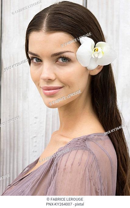 Portrait of a woman wearing flowers