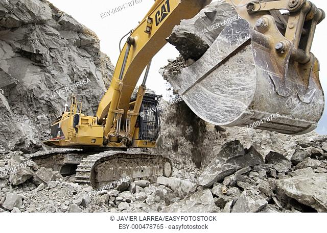 Extracting raw material from quarry for cement manufacturing