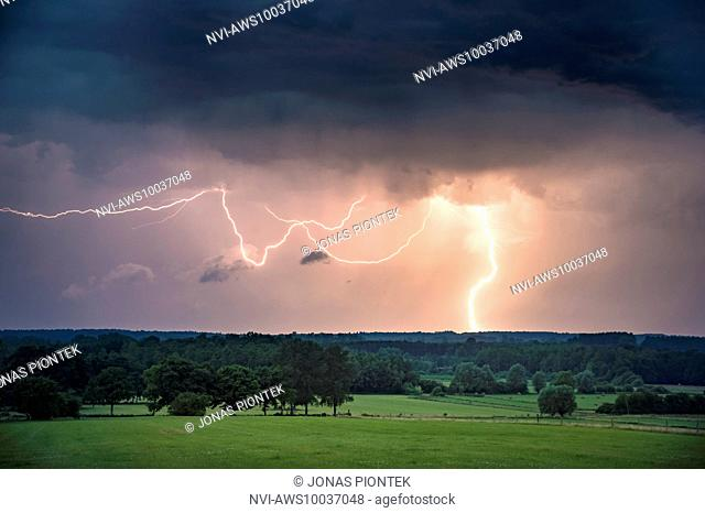 Cloud-to-ground lightning during the blue hour near Étalle, Belgium, Europe