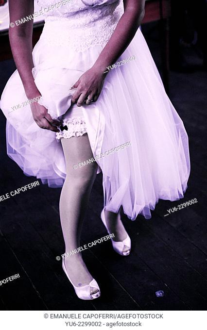 Bride showing garter