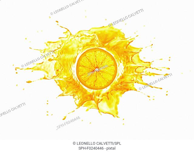 Big splash with orange slice in the middle. lit up from behind, Isolated on white background
