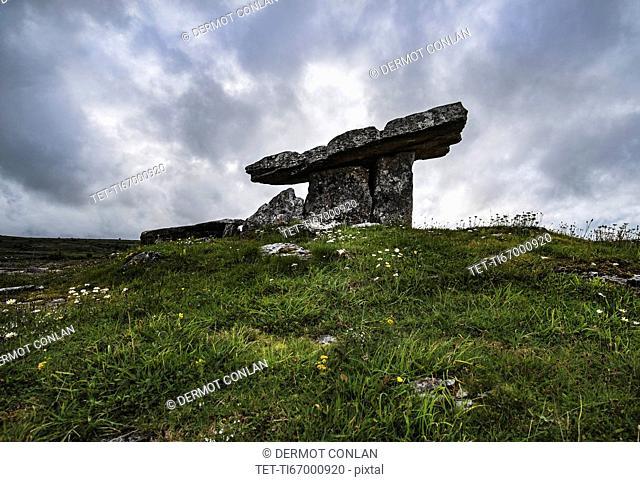 Ireland, Clare County, Burren, Poulnabrone Dolmen under overcast sky