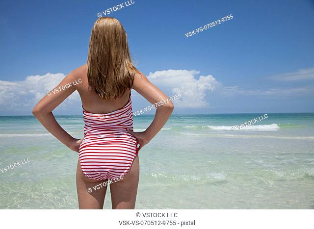 USA, Florida, St. Petersburg, rear view of girl (12-13) looking at view