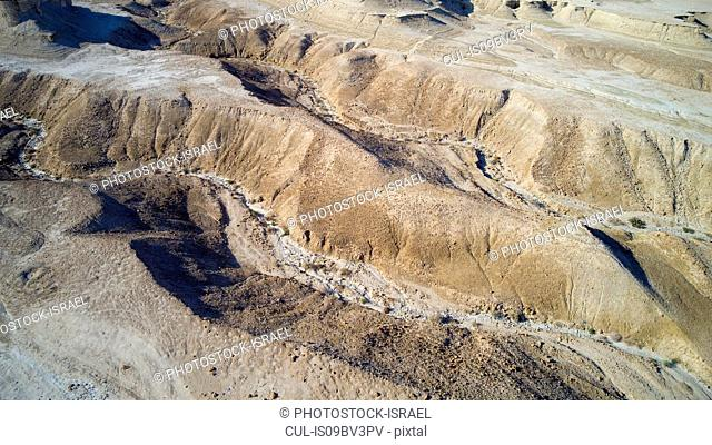 Eroded sandstone mountains on sea shore, Dead Sea, Israel. Aerial photography with drone