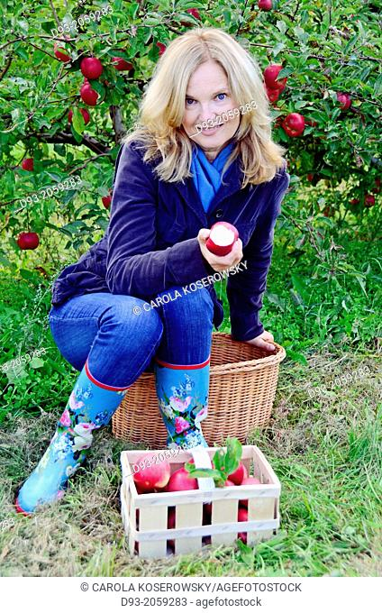 A lovely middle-aged woman eating Apple