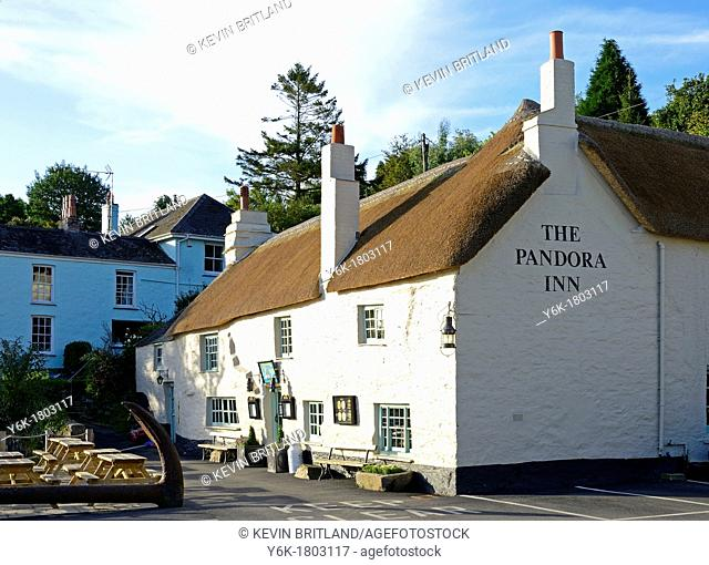 a thatched roof cottage style pub, by restronguet creek on the river fal, near falmouth in cornwall, england, uk