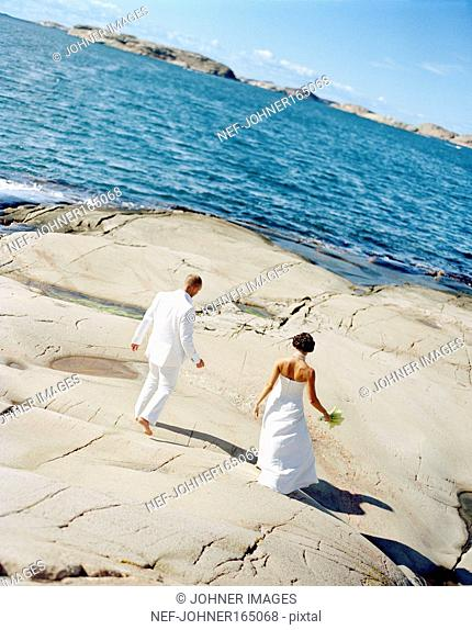 A bridal couple by the sea