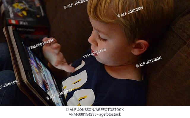 Boy, 5 years old, play using a tablet computer