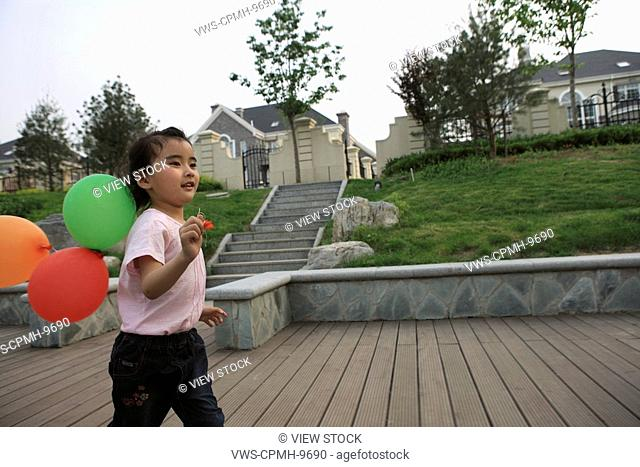 Chinese Girl Holding And Playing The Balloon,Beijing