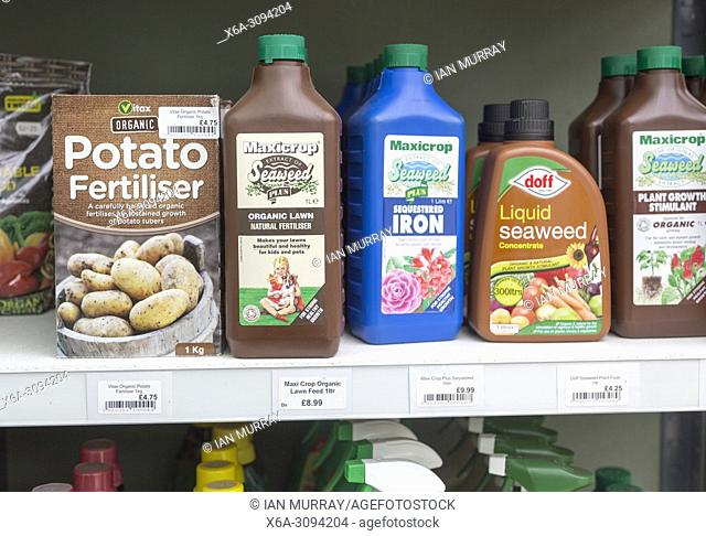 A range of fertiliser products on sale at The Walled garden plant nursery, Benhall, Suffolk, England, UK