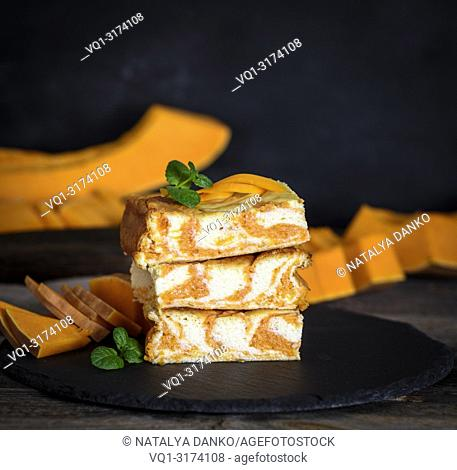stack of square baked cheesecake from cottage cheese with pumpkin
