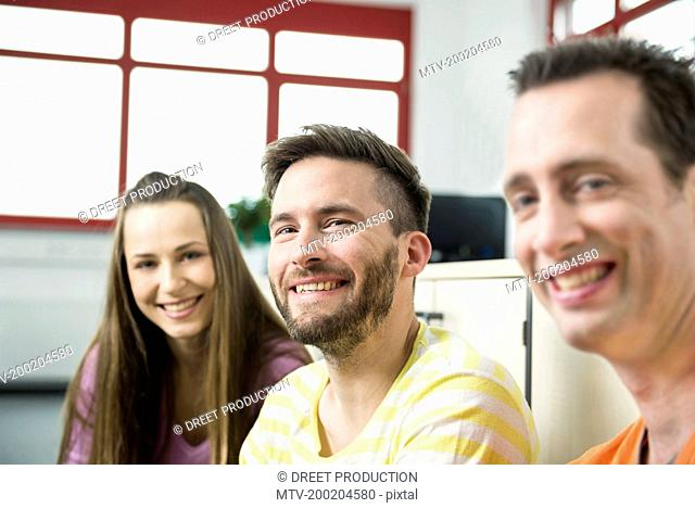 Three young work colleagues one woman two men
