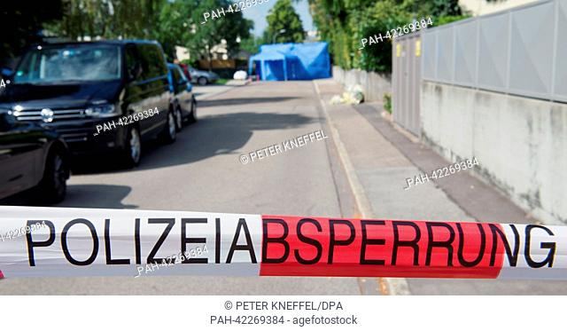 View of a police cordon in front of a barrier of a crime scene in a residential area in Ingolstadt, Germany, 03 September 2013