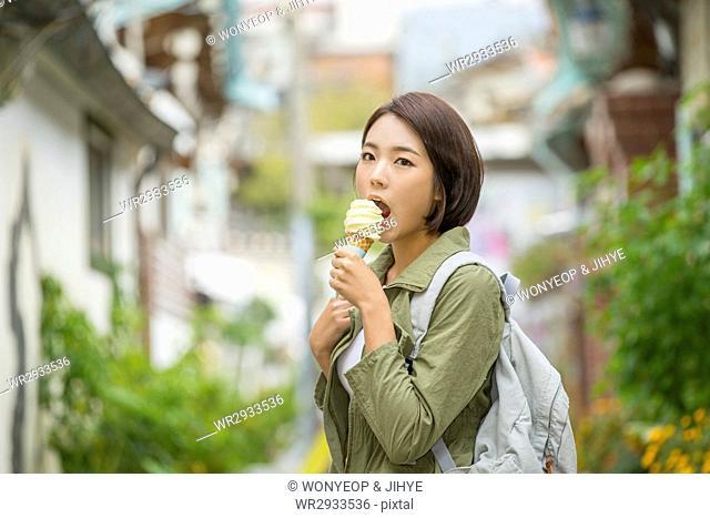 Young female tourist at Korean village
