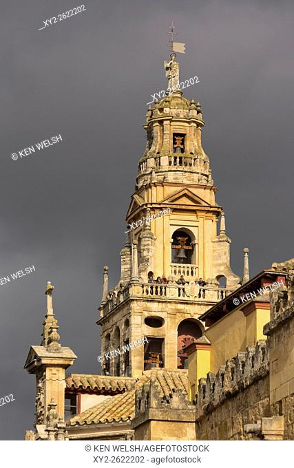 Cordoba, Cordoba Province, Andalusia, southern Spain. The Alminar bell tower of the Cordoba mosque against a stormy sky. Alminar means minaret