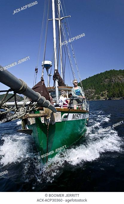 Passengers aboard Misty Isle's, a 42 ft schooner enjoy the scenic pleasures of Desolation sound. British Columbia, Canada