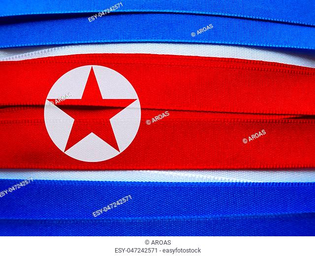 North Korea flag or banner made with red, blue and white ribbons