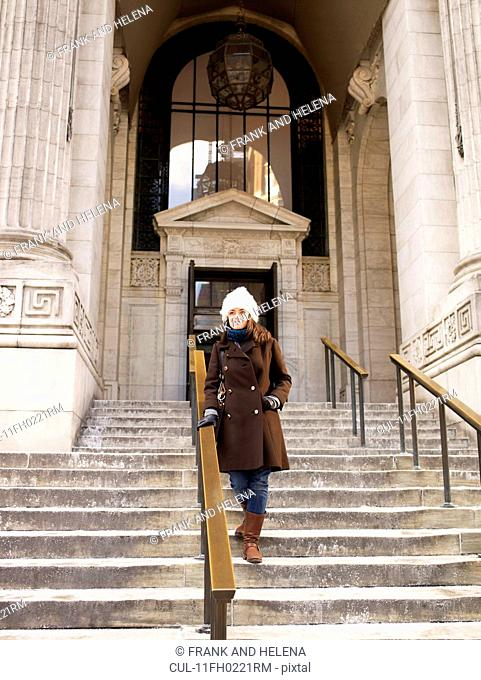 Woman on steps of New York Library