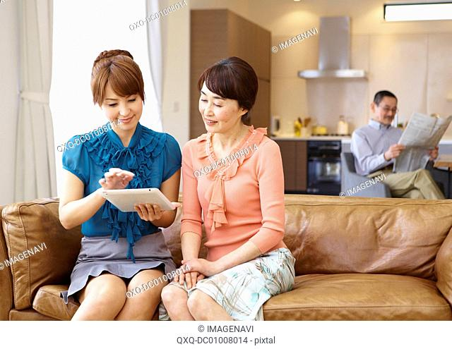 Two women using tablet PC