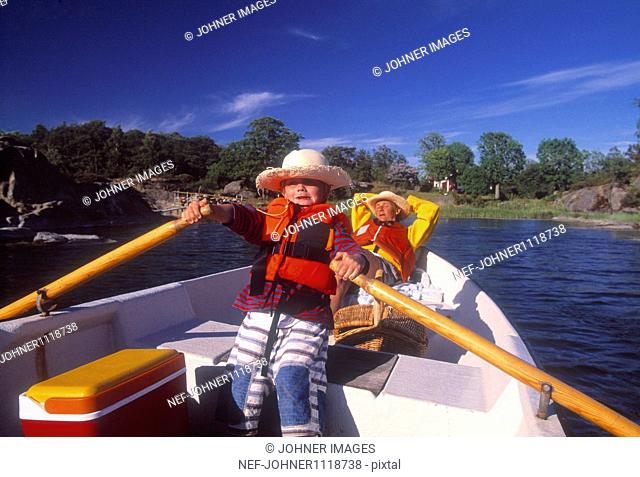 Mother and son boating on lake