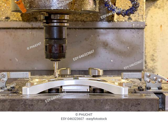 The CNC milling machine cutting the automotive part with solid ball endmill