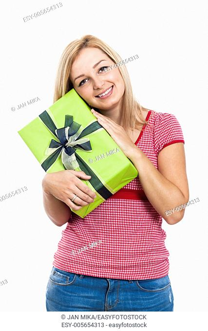 Young happy woman holding present, isolated on white background