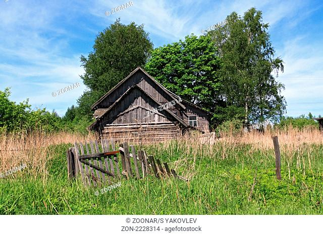 old rural house amongst tree