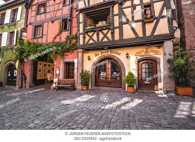old timbered houses with carvings in the village Riquewihr, Alsace, France, typic Alsatien tourist destination